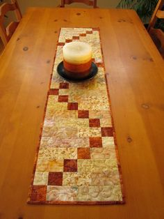 Batik Quilted Table Runner Gold and Rust Patchwork Table Runner, Table Runner And Placemats, Quilted Table Runners, Batik Quilts, Fall Quilts, Place Mats Quilted, Quilted Table Toppers, Tablerunners, Sewing Table