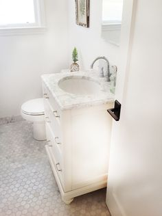 Gorgeous Carrara marble hexagon in this beautiful bathroom