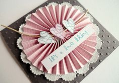 handmade Valentine: love thing by ..::aga::.., via Flickr ... luv the colors on this one: dusty pink, medium gray and white with hints of aqua in stamping ... three hearts on a rosette on a doily on a gray dot embossed card ... luv it !!