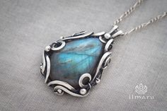 Sterling silver pendant with labradorite in wire wrapping technique.