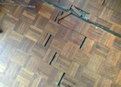 Wooden floor repair in Cambridge...  When a parquet floor is really badly damaged, the parquet strips will need to glued to the sub floor before sanding and sealing.