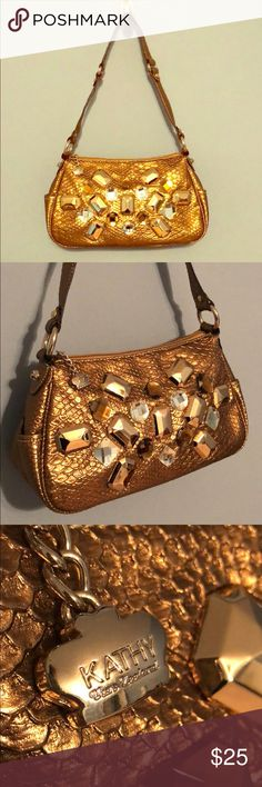 👑Kathy Van Zeeland Glam Handbag - Metallic Bronze Kathy Zan Zeeland Metallic bronze shoulder bag. Gems all intact on front. Gold hardware. Two small side pockets. Zipper pocket on interior and exterior. The inside & outside are spotless. Faux crocodile leather. Smoke free home! Kathy Van Zeeland Bags Shoulder Bags