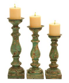~ 2 sets for DR table(?); Antique-inspired and rustic, this set is the perfect way to express personal style in home décor. An elegant way to accent a table or shelf, this set of candleholders provides that final touch. Includes three candleholdersSmall: 12'' HMedium: 14'' HLarge: 15'' H