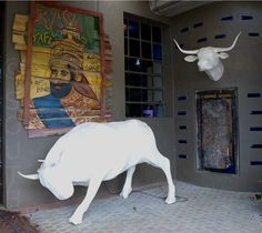 Papier mâché bull trophee head & full size bull as lamp. A witty reference to the mounted-head trophies of stiff-upper-lip, pith-helmet colonial times. South African designer Michael  - handmade - functional art - www.south-design.nl