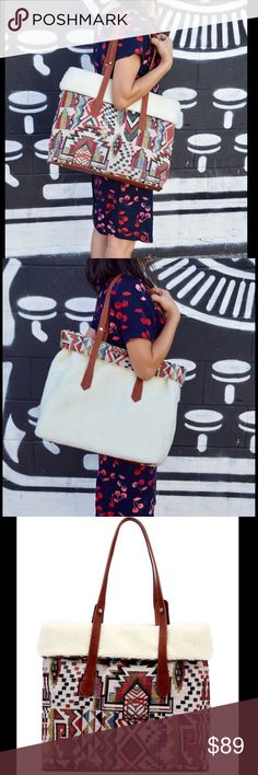 """[COMING SOON] Reversible Tribal Print Tote Reversible tribal print tote   Handle style: Double Material: Faux leather   Features: -Faux fur lining -Worldly fabric textiles -Classic silhouettes  H: 13"""" W: 17.5"""" D: 6"""" Boutique Bags Totes"""