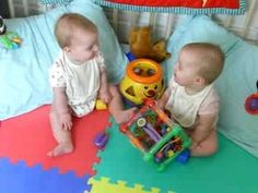 Baby twins in conversation