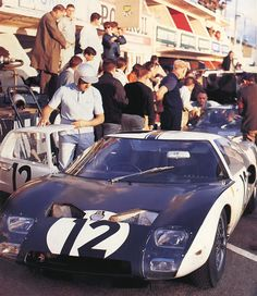 Jean Louis Schlesser dives into his Ford GT40 at Le Mans 1964.