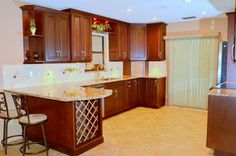 Traditional kitchen with wine rack by Da Vinci Cabinetry in Naples, FL