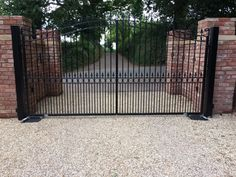 """Metal driveway gates - the Goldsworth. Stunning estate gate mounted on metal posts with underground automation. Finished with our """"Longlife"""" system in black. Electric Driveway Gates, Metal Driveway Gates, Metal Garden Gates, Electric Gates, Metal Gates, Wooden Gates, Wrought Iron Gates, Side Gates, Gate Ideas"""