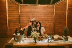 Abby and Collin toasted their marriage with a shot of honey bourbon and had an amazing Gluiness flavoured cake made by a local baker. Photos & vidoe by Josh Arroyo & Sam Arroyo. See their video here...@intimateweddings.com #reception #sweethearttable #elopement