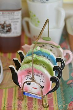 """I'll hold the bag!"" tea bag holders. I have the tea bag holders now I just need the holder for them!"