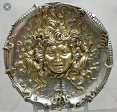 A plaque in the Art Nouveau style (1911). This depiction of Medusa caught my eye because it was before her hair was turned to snakes. The gold embodies the beauty she had before she betrayed Athena. I also like how there are snakes coming toward her, foreshadowing the transformation that is about to take place. The look of terror on her face shows that she is aware of the terrible mistake she made and the consequences that are to come.