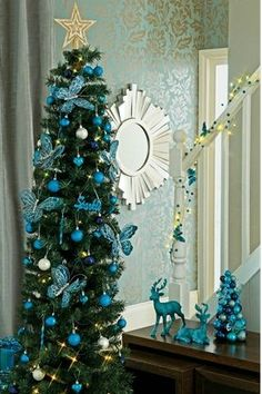 Skinny teal Christmas tree. Great for small spaces.