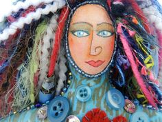 Look at the colors on this soft sculpture hand crafted doll.  Who doesn't have old yarn, buttons, sequins and creative findings in their junk drawer?