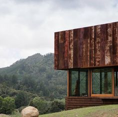 House of the Day: K Valley House by Herbst Architects This house built into the steep hillside of New Zealands Kauaeranga Valley was designed with a focus on sustainability and the provenance of materials. The corrugated iron exterior draws from the traditional rusting iron sheds common in the district and has begun to develop a distinctive patina of age intended as a kind of rural camouflage. Photography: Lance Herbst #themodernhouse #houseoftheday #herbstarchitects #kvalleyhouse #newzea...