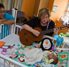 An Ordinary Day in the Life of a Music Therapist at Children's Hospital of Pittsburgh of UPMC   Music and Wellness [Deborah plays her guitar for a baby in the NICU] A wonderful article!