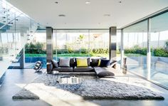 ... , grey shag rug, and floor to ceiling windows in the Flip Flop House