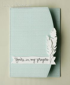 handmade sympathy card ...  pale blue printed paper ... machine sewn edges ... front with curved cut and a pair of die cut feathers ... clean and simple ...