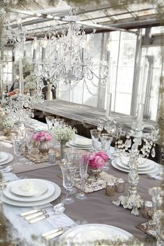 Shades of white and cream china settings, mixed metals, crystal, and vintage silver for an elegant table.