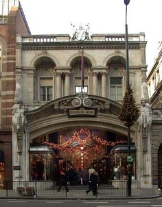 Burlington Arcade  London's Burlington Arcade was the world's first shopping arcade, opened in 1819 to great acclaim and now recognised as a historic and architectural masterpiece. The   Burlington Arcade, Piccadilly Entrance. London W1. Built by Samuel Ware in 1818-19, rebuilt by Beresford Pite in 1911   Burlington Arcade is one of the longest covered shopping streets in Britain.