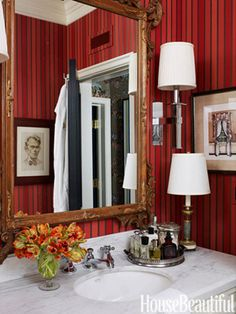 "Since the apartment only has one bathroom, it also has to function as the powder room, so Nye wanted it to be ""slightly dramatic, and as elegant as possible."" He covered the walls with Cowtan & Tout's Laurent Stripe in Red and Gold and hung a mirror. Bathroom Color Schemes, Bathroom Paint Colors, Bathroom Red, Red Bathrooms, Colorful Bathroom, Bathroom Ideas, Small Bathroom, Bathroom Plans, Bathroom Basin"