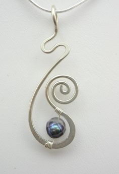 Sterling Silver and Pearl Freeform Hammered Wire Wrapped Pendant. $25.00, via Et...
