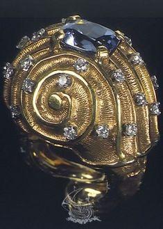 Salvador Dali, 1949, 18 karat yellow gold, natural sapphire, diamonds.