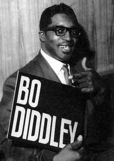 Bo Diddley (December 30, 1928 – June 2, 2008), born Ellas Otha Bates but changed as a child to Ellas McDaniel, was an American R&B vocalist, guitarist, songwriter and music producer, usually as Ellas McDaniel, and had cameo appearances in movies. He was nicknamed The Originator and influenced a host of acts, including Elvis Presley, Buddy Holly, the Beatles,the Rolling Stones, Eric Clapton, the Who, the Animals,,Jimi Hendrix, Parliament Funkadelic