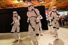 """Watch a group of Stormtroopers unveil the new 'Star Wars: The Force Awakens' toys with dance in the Times Square Toys """"R"""" Us on Force Friday."""