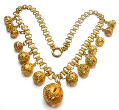 Art Deco Victorian revival book chain w/ filigree balls necklace.  circa 1930