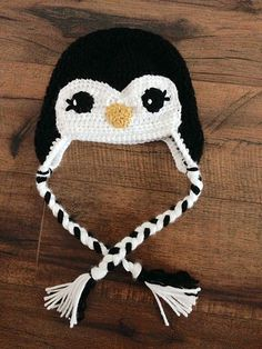 http://www.ravelry.com/patterns/library/penguin-crochet-hat