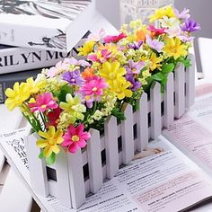 Country Style Multicolor Daisies in White Fence . Gift for mom on Mother's Day? Nothing's better than flowers!