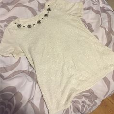 Detailed Crystal Shirt Very cute shirt with neckline embellishments. Very easy to dress up and down. Great condition and very comfortable. The shirt size is a small but runs a little big. #dressy #cute #crystals #sparkly Ann Taylor Tops Tees - Short Sleeve
