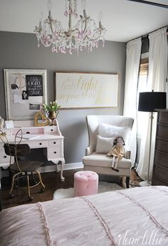 Fuzzy pillows and fun desk accessories from HomeGoods add finishing touches to this sweet little gray and pink little girls room. (sponsored pin)