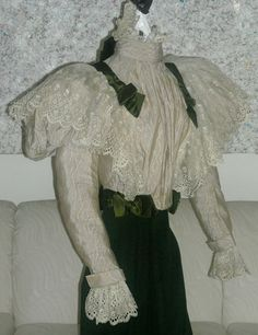 """1890: Victorian bodice (the skirt shown with it is a different listing - walking suit - and is not included in this listing).   It is a light beige pinstripe cotton with a tiny diamond pattern all over and is trimmed in beautiful lace and green silk ribbons & bows.  It has a high neck, """"pigeon"""" front, and huge puffs on top of each sleeve. It also has hooks and eyes to fasten it up the front and stays."""
