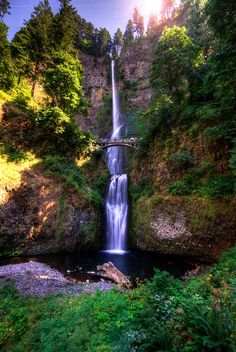 Multnomah Falls, Portland, Oregon I've been there!I got soaked. Note:Bring your own umbrella,or dont let your sister hold it.