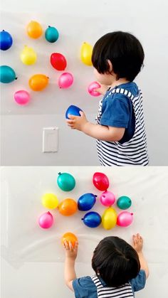 Sticky Wall Balloon Sensory Activity for babies and toddlers. Great fine motor skills activity! Learn colors and counting too #hellowonderful.