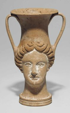 AN APULIAN POTTERY FIGURAL KANTHAROS CIRCA LATE 4TH CENTURY B.C. In the form of…