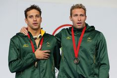 Gold medallist Chad le Clos (L) of South Africa poses with bronze medallist Sebastien Rousseau of South Africa Swimming World, Commonwealth Games, World Cup, South Africa, Windbreaker, Bronze, Celebs, Poses, Gold