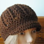 Free Newsboy Crochet Hat Pattern  -  Another style of newsboy hat.  I like the texturing of this one, but it isn't quite as simple.