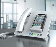 Turn your iPhone into a truly professional work phone with this iPhone landline dock. With crisp sound quality from the headset and the ability to charge your iPhone while it's plugged in, the iPhone landline dock is perfect for transitioning in and out of work mode.