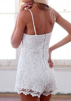Angled back view of model in white lace cami romper
