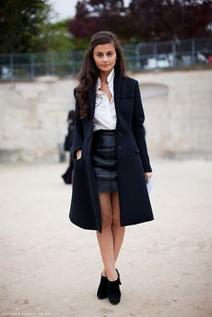 black leather skirt + white button down. simple to accessorize. love her hair