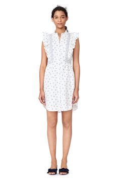 A floral print shirtdress with ruffle trim.