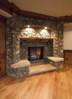Stone fireplace with two seats.