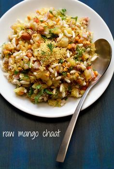 raw mango chaat - tangy and spicy chaat made with raw mangoes, puffed rice and other ingredients.