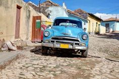 An old classic car on a Trinidad street. Image by Drazen Vukelic / E+ / Getty Images. http://www.lonelyplanet.com/travel-tips-and-articles/lonely-planets-best-in-travel-2014-top-10-cities