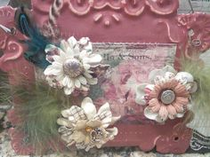 Magnet flowers from old beads or buttons on paper flowers.