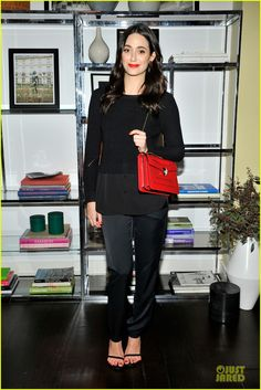 Emmy Rossum adds a pop of red to her outfit while attending the Sandro Paris celebration held at Chateau Marmont on Thursday (March 20) in Los Angeles.