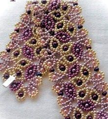 11/o seed beads and 3mm round pearls and 2.8mm Miyuki drop beads. From jayceepatterns.com, Juanita Carlos, one of the most talented and helpful designers out there, in my opinion.